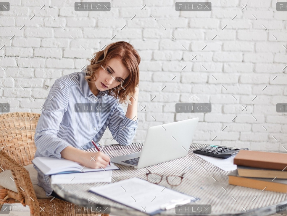 woman-freelancer-female-hands-with-pen-writing-on-P369BAX1